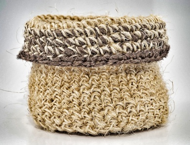 Hand-crocheted sisal basket trimmed with bronze fabric strips by zed handmade