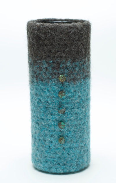 BOL hand felted vase is glass lined, gunmetal and seafoam color with turquoise hand cut attachments