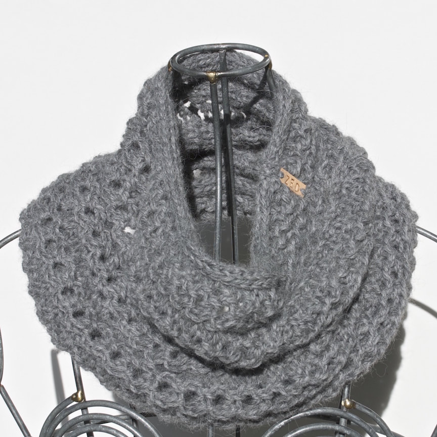 Ocho is a hand knit pewter coloured cowl made with 100% Peruvian alpaca wool