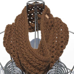 Ocho is a hand knit cinnamon coloured cowl made with 100% Peruvian alpaca wool