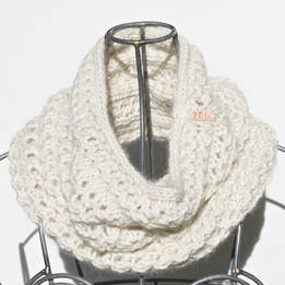 Ocho is a hand knit natural coloured cowl made with 100% Peruvian alpaca wool