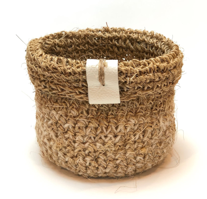 JUTE is a hand-crocheted vessel made with jute and pure wool by zed handmade