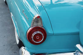 Pristine old car in sea turquoise South Beach Miami