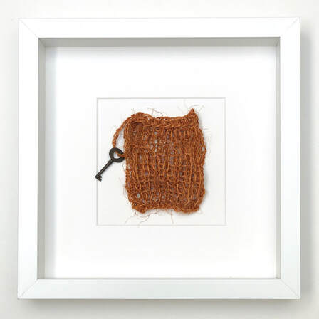 FRAMED - toffee coloured japanese fiqué knitted into a pouch with antique key hanging 9x9 zed handmade