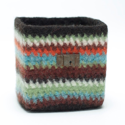 BOL Fair Isle is a felted bowl with a highlighter yellow centre and black & grey stitches that look like a sweater